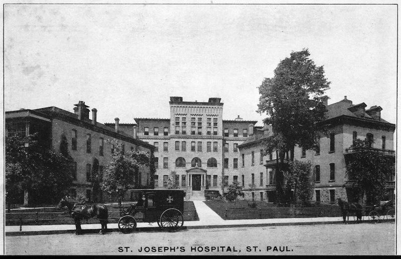 St. Joseph's Hospital with horse and ambulance, Saint Paul, Minnesota