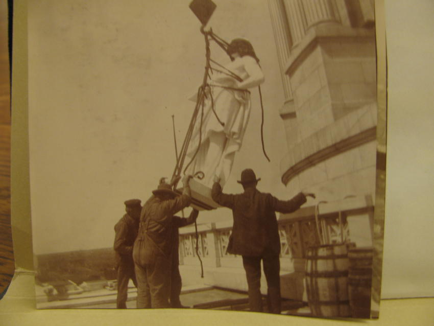 Setting one of six Virtues statues in place