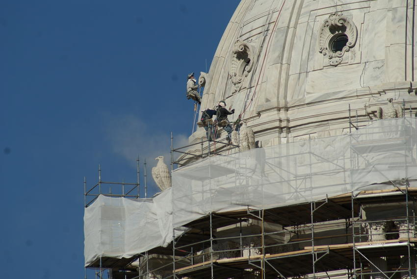 Workers cleaning and tuck pointing dome, 2011