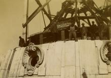 Workers atop Capitol dome