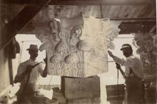 Stonecutters carving ornate capital